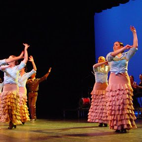 dancers in ruffled skirts onstage